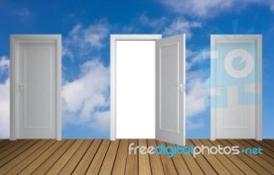 white doors against a blue sky