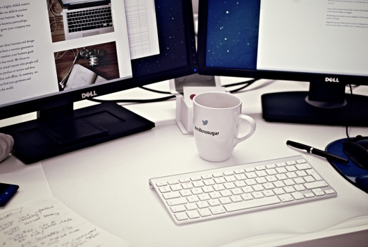computer and coffee mug