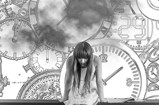 sad girl surrounded by clocks